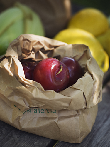 Plums in a paper bag, Sweden.