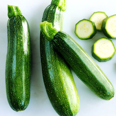 Whole and sliced courgettes